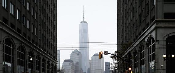 The One World Trade Center is seen in background as a woman pushes a cart in Exchange place, New Jersey