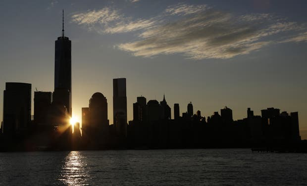 The sun rises next to One World Trade Center, Monday, Nov.
