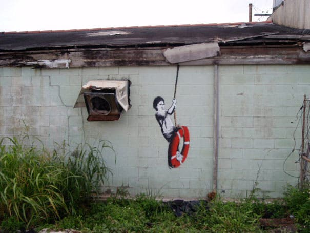 wpid-banksy-graffiti-street-art-boy-on-lifebuoy.jpg