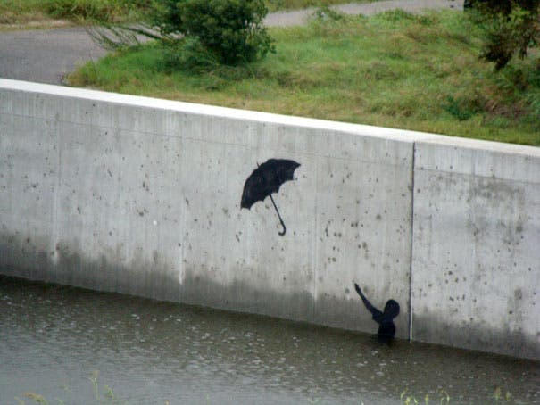 wpid-banksy-graffiti-street-art-boy-umbrella.jpg