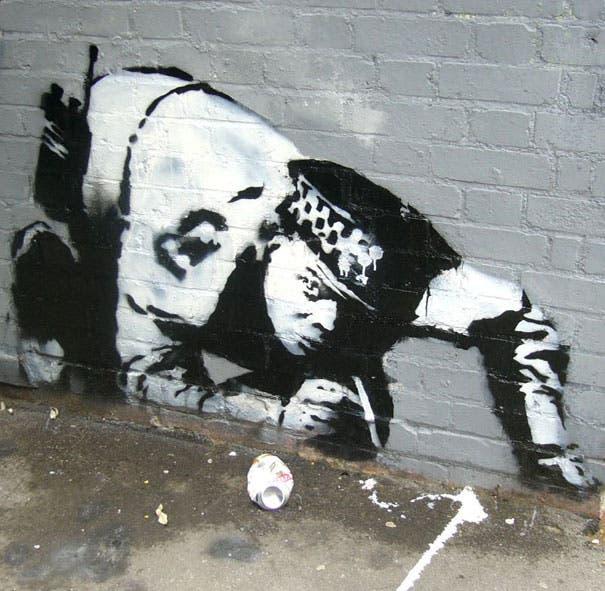 wpid-banksy-graffiti-street-art-cop-snorting.jpg