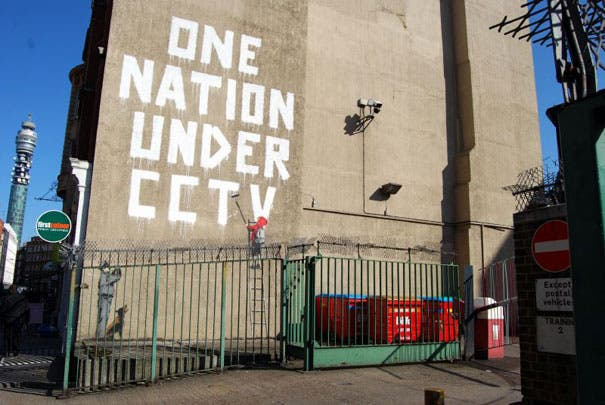 wpid-banksy-graffiti-street-art-one-nation-under-cctv-1.jpg.jpeg