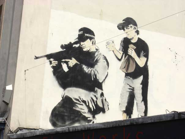 wpid-banksy-graffiti-street-art-sniper-and-boy.jpg