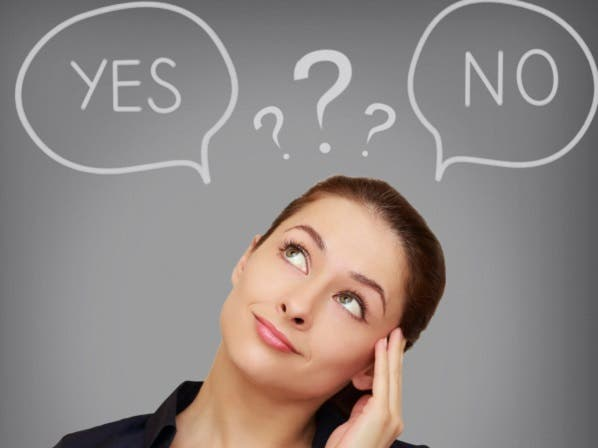 Business thinking woman with yes or on in speech bubble