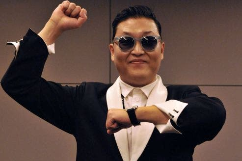 South Korean singer Psy gestures during a press conference on November 6, 2012 in Paris.    AFP PHOTO MEHDI FEDOUACH