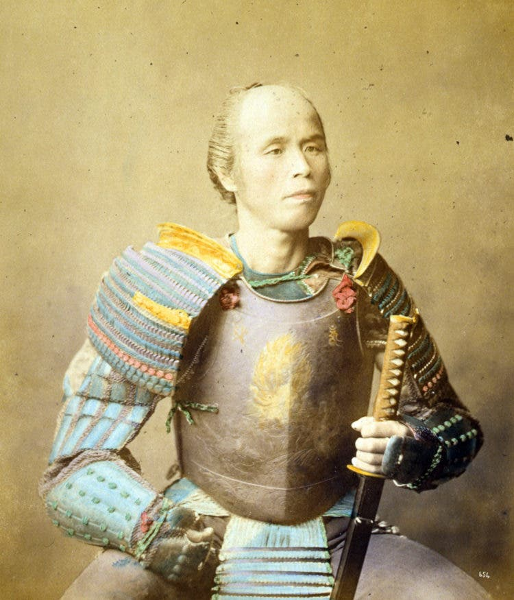 Photographic print of a Samurai warrior wearing armor and holding a sword. Dated 1877 Photo by: (Universal History Archive/UIG via Getty images)