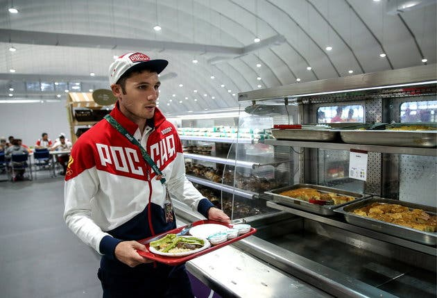 RIO DE JANEIRO, BRAZIL AUGUST 2, 2016: Russian boxer Andrei Zamkovoi having lunch in the canteen in the Olympic village ahead of the Rio 2016 Summer Olympics. Valery Sharifulin/TASS (Photo by Valery SharifulinTASS via Getty Images)