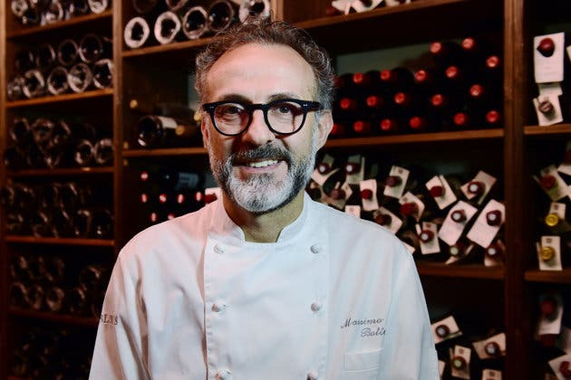 "A picture taken on July 7, 2016 shows Italian chef Massimo Bottura posing in the kitchen of his restaurant ""Osteria Francescana"" in Modena. / AFP / GIUSEPPE CACACE (Photo credit should read GIUSEPPE CACACE/AFP/Getty Images)"