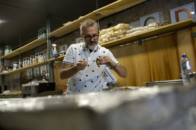 Italian chef Massimo Bottura works at his gourmet soup kitchen, ReffetoRio Gastromotiva, in Rio de Janeiro, Brazil, Sunday, Aug. 14, 2016. Using leftover ingredients from Olympic caterers and other local partners, Bottura created the gourmet soup kitchen that for a week now has been serving up meals to Rio's homeless. (AP Photo/Silvia Izquierdo)
