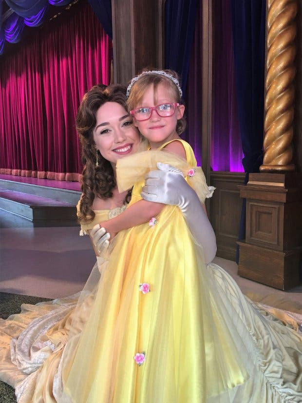 PIC BY CATERS NEWS - (PICTURED: Cailee at Disneyland with Belle in July) - A doting mum has planned a sightseeing bucket list for her little daughter who has an incurable eye condition that may eventually leave her blind. At just two-years-old Cailee Herrell, 6, was diagnosed with a rare disease, Familial exudative vitreoretinopathy (FEVR), which causes progressive vision loss. Before the little girl loses her sight completely, her family from Phoenix, Arizona, USA, want to complete a visual bucket list to fill her memory bank for the future. The heart-warming list included Cailees first trip to the ocean and fulfilling her dream of a magical holiday to Disneyland. SEE CATERS COPY